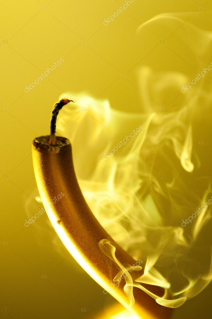 Smoking candle on colourful vivid background — Stock Photo #11439130