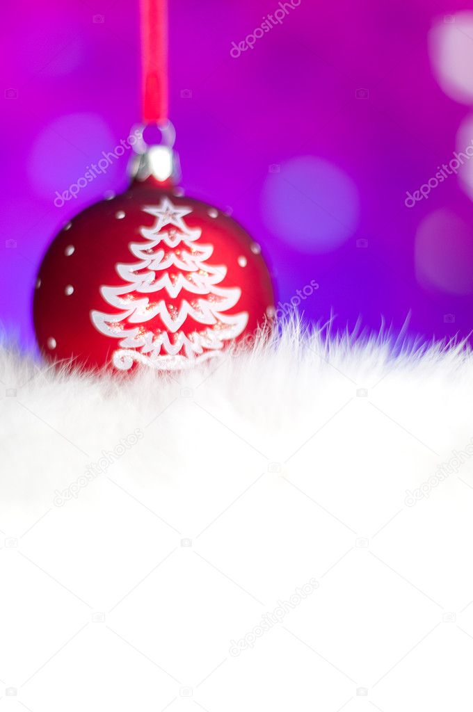 Red christmas toy ball in the white fur with blurry background, shallow depth of field. Place for your copy — Stockfoto #11439250