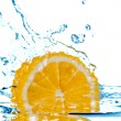 Lemon fall in water with splash — Foto Stock