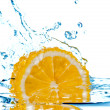 Lemon fall in water with splash — Stockfoto