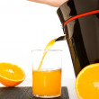 Making orange juice - Stock Photo