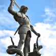Old statue depicting man killing dragon — Stock Photo