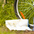 Royalty-Free Stock Photo: Bottle of water and near bicycle wheel