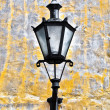 Old lantern on old wall - Stock Photo