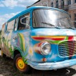 Foto Stock: Old painted car in street