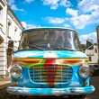 Old painted car in street - Stock Photo