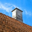 Tiled roof top with  chimney — Stock Photo
