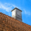Stock Photo: Tiled roof top with chimney