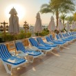 Sunset over beach lounge — Stock Photo #11440575