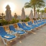 Sunset over beach lounge — Stock Photo