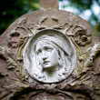 Woman face on tombstone — Stock Photo
