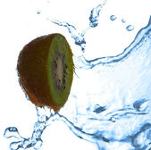 Splash of water on kiwi — Stock Photo