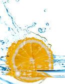 Lemon fall in water with splash — Stock Photo