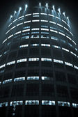 Office building at night — Stock Photo