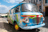 Old painted car in street — Stockfoto
