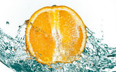 Water splash on orange — Stock Photo