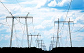 Power grid pylons — Stock Photo