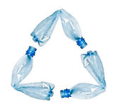 Plastic bottles making up recycle symbol — Stockfoto
