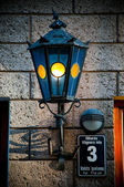Old lantern on old wall — Stock Photo