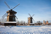 Two windmills and church — Stock Photo