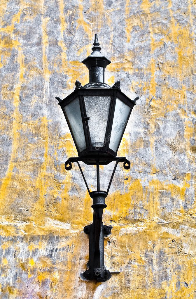 Old lantern on yellow wall in street of Tallin old town, Estonia  Stock Photo #11440202