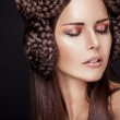 Beautiful fashion model with a creative hairstyling — Stock Photo