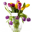 Colorful tulips in vase with a card - Stock Photo
