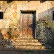 Stockfoto: Unkempt wall and door