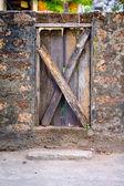 Wood Door Embedded in Stone — Stock Photo