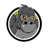 Angry cartoon gorilla in a badge — Stock Vector