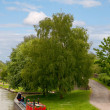 Colourful Narrowboat on the Canal - Stock Photo