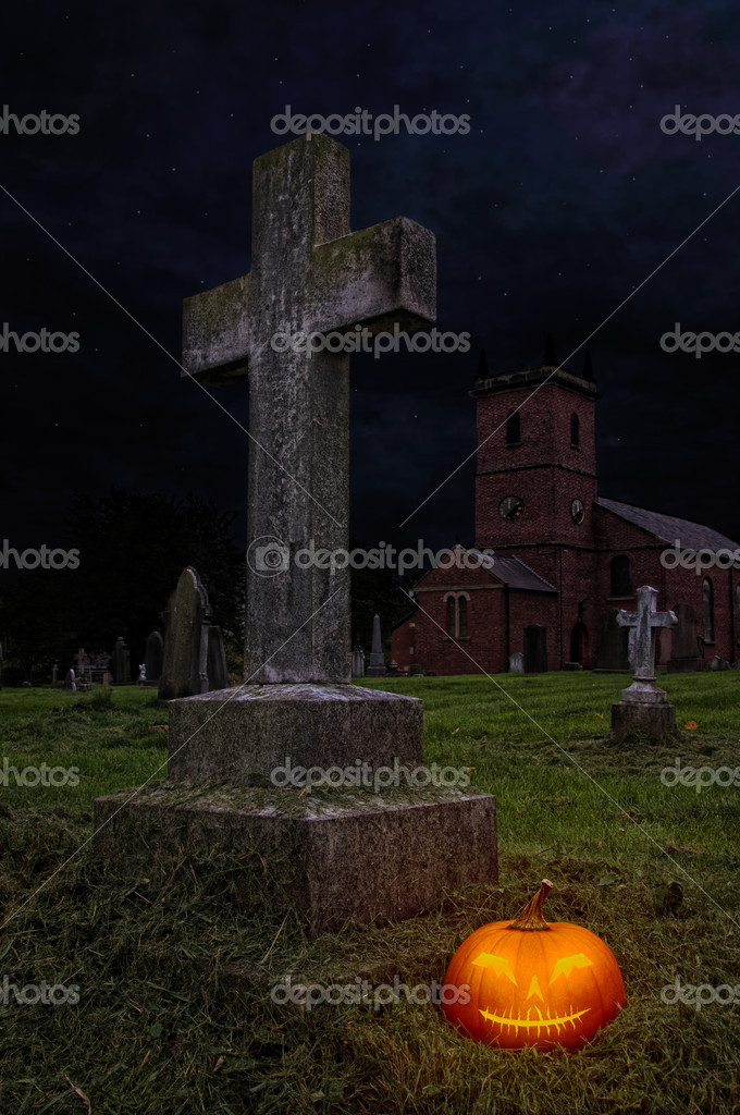 Halloween pumpkin lantern in churchyard at night — Photo #11466252