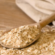 Stock Photo: Oats On Rustic Spoon