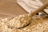 Oats On Rustic Spoon — Stock Photo