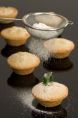 Dusting Mince Pies — Stock Photo