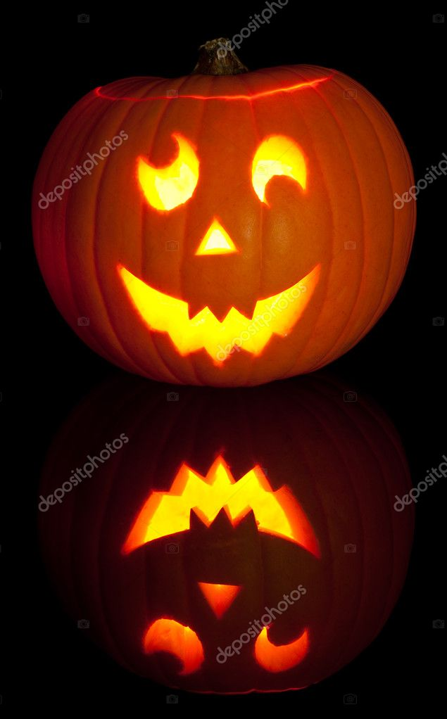 Lit Jack O Lantern for Halloween on black background — Stock Photo #11573474