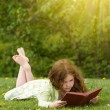 Girl Reading Outdoors - Stock Photo