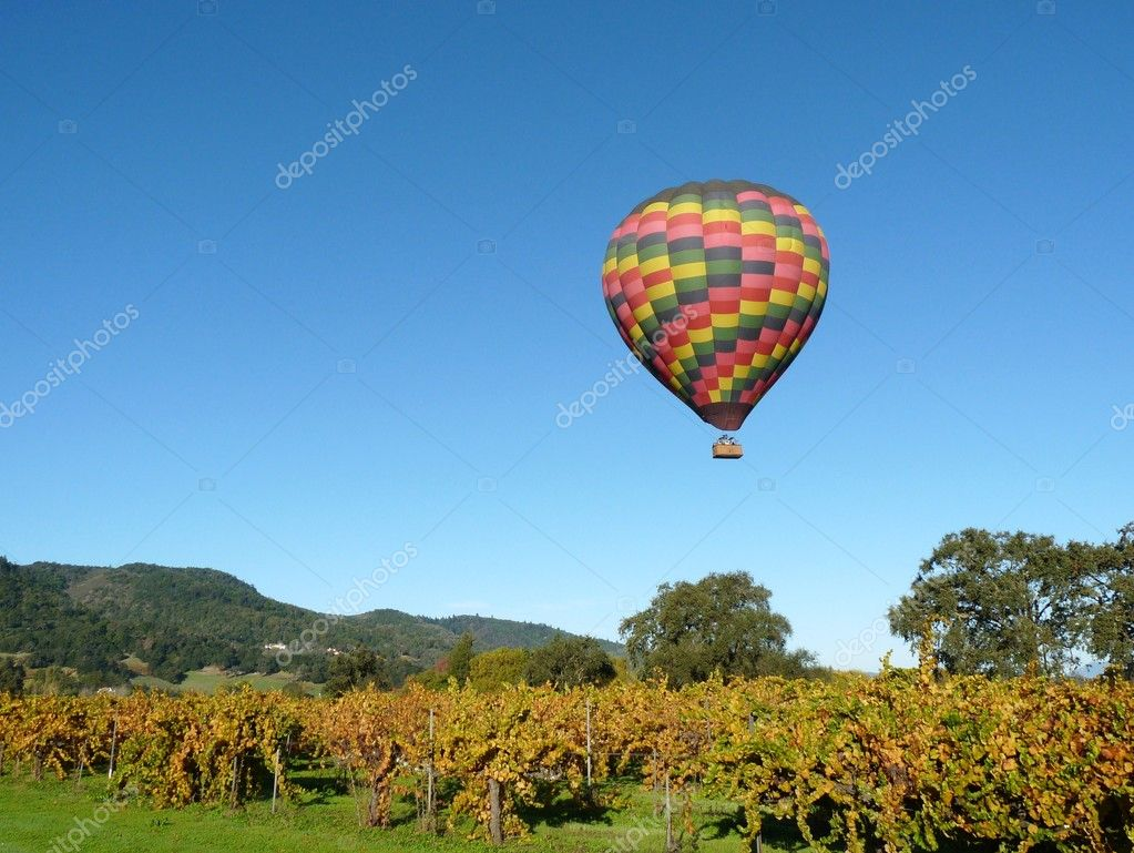 Hot Air Ballon floating in Napa Valley Vineyards — Stock Photo #11421439