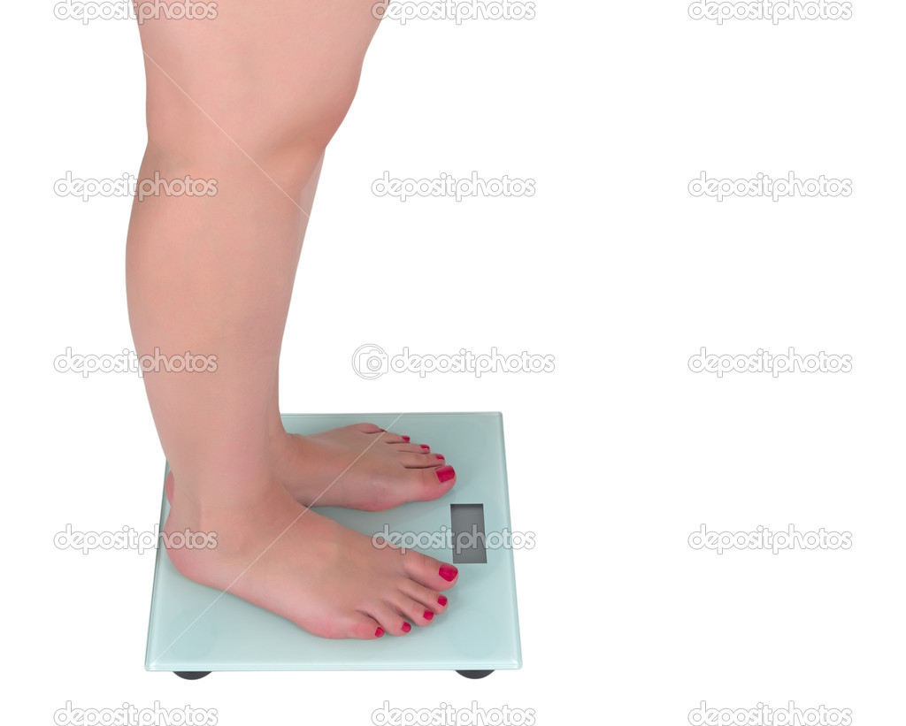 Woman on the digital scale with display, white background — Stock Photo #11431425