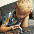 Boy on ipad - Stock Photo