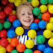 Boy in fun balls — Stock Photo