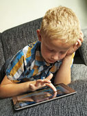Boy on ipad — Stock Photo