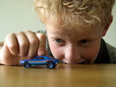 Boy with toy car — Stock Photo