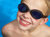 Boy in pool — Stock fotografie