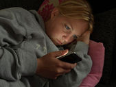 Reading smartphone in evening — Stock Photo