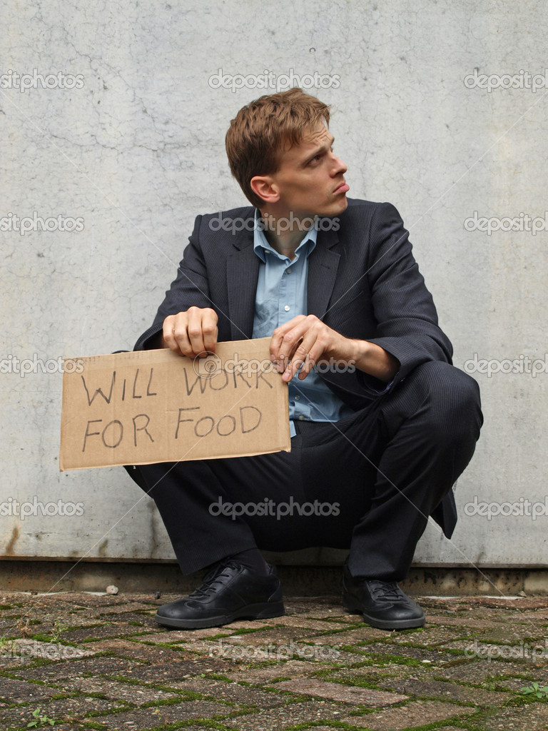 Jobless man on the street with a will work for food sign — Stock Photo #11503710