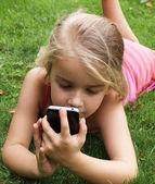 Girl with smartphone — Stock Photo