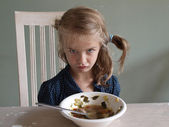 Angry girl does not eat — Stock Photo