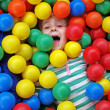 Stock Photo: Girl in fun balls