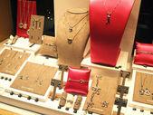Jewelry in window shop — Stock Photo